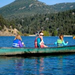 evergreen boating canoe lake mountains hills evergreen, colorado town