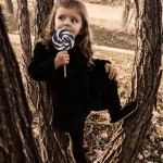 Amelie cute kid girl lollipop kids photography ideas trees fall winter sepia