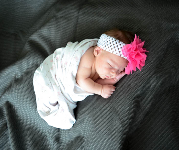 newborn photography photo portraits unique pink girl  black and white flower headband chubby soft sweet