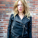 fashion style ombre hair leather jacket studs rachel roy boots leather tights and shorts sparkle silver forever 21 stephanie may maydae brick wall selfie colorado biker motorcycle jacket